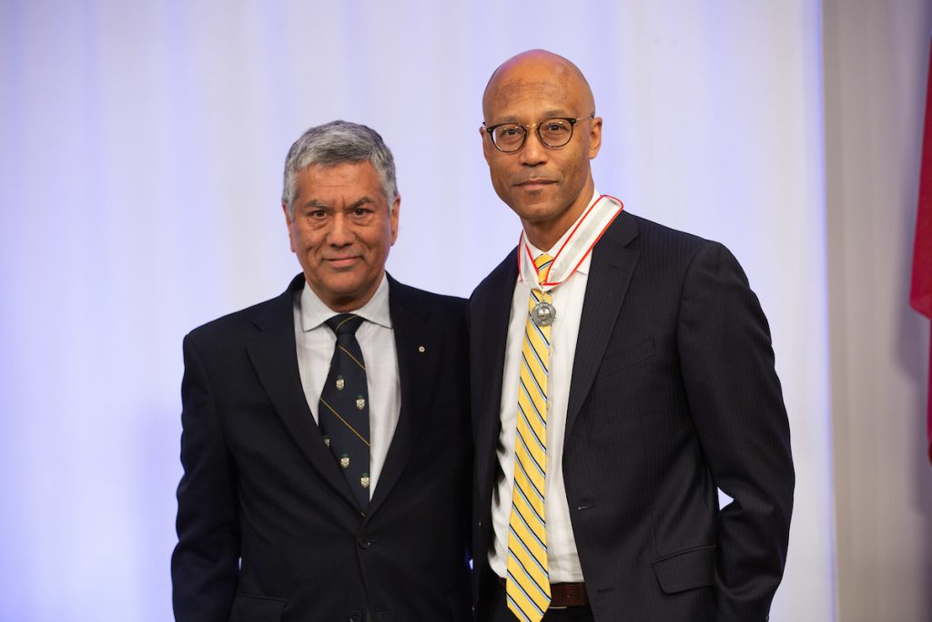 WeirFoulds Partner Raj Anand stands with Frank Walwyn after he is awarded a 2019 LSM